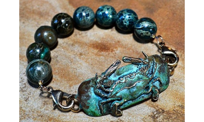 Crabs motif jewelry by Elaine Coyne Galleries.